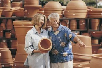 Terra cotta keeps plants cool in hot weather, but the pot may not have a drainage hole.