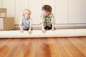 Protect your family from unnecessary spills -- stop rugs from skidding by applying backing.