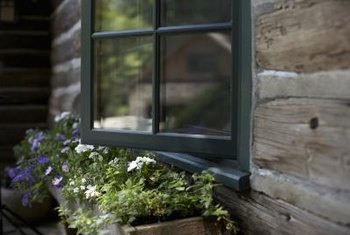 Window boxes provide easy access for plant care.