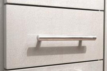 Sanding metal drawer pulls allows primer and paint to adhere properly.
