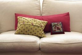 New cushions can liven up an old sofa.