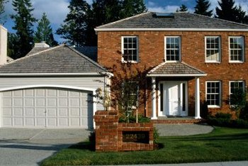 Neutral siding works well to create a contrast with any color of brick.