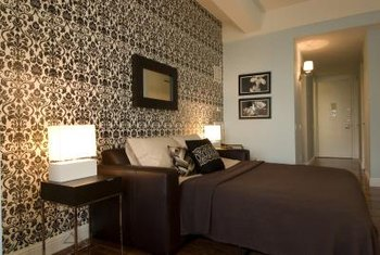 The wall behind your bed is an ideal spot for a wallpapered feature wall.