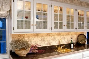 Some soffits are covered with wallpaper or backsplash tile to tie them into the kitchen design.
