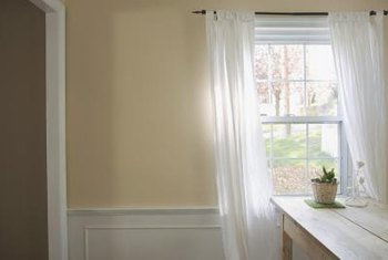 Waist-high paneling known as wainscot can be installed over existing tile walls.