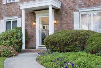 On a corner lot, paved walkways make it easier to cross the large lawn.