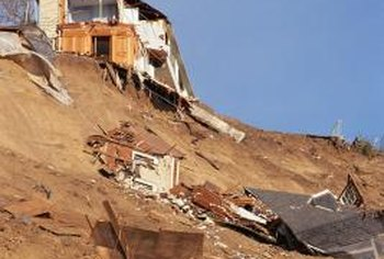 A house on an unstable hillside may be undermined by heavy rains and fall down the slope.