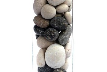 Smooth stones and river rocks piled in a glass cylinder complement your Zen retreat buffet table.