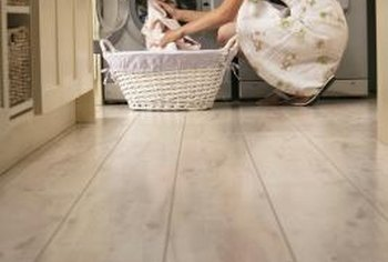 "Front-loading washers on wood floors frequently ""walk"" during spin cycles."