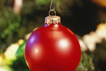Give your red holiday ornaments a summer job protecting your tomatoes.