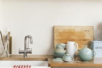 Store your dish towels in a decorative basket on the top shelf.