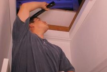 Attic doors are usually push-up panels accessed by a ladder.