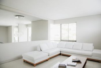 A large sectional that blends with the walls is less visually invasive.