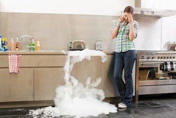 Using the wrong detergent in your dishwasher can cause water and suds to leak from the base.