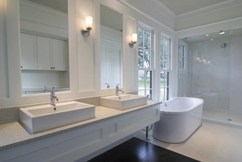 Bathroom mirrors here are simple, symmetrical and sized the exact same.