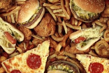 Pizza, burgers and other fast foods can cause weight gain.