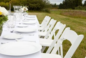 Dress up bare chairs with self-tie covers for an elegant event.