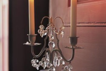 Flower petals add romantic appeal around the base of a crystal candleabra.