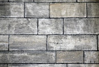 Whitewashed brick has variegated color, unlike the uniform color of painted brick.