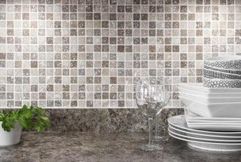 You can go with tile that picks up the tone of the countertops in the kitchen.