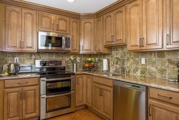 the warmth of honey spice cabinetry allows a variety of backdrop wall colors