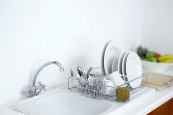 It is often easier to install the drain baskets in acrylic sinks prior to installing the sink in the counter top.