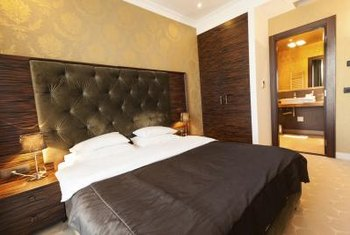 Golden yellow walls add warmth to a room with chocolate brown bedding.
