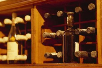 Premade or homemade dividers turn an empty cabinet into a wine rack.