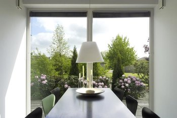 Fully open fabric window treatments create a thin layer at the top to maximize the light from the outdoors.