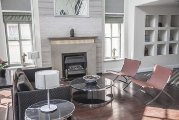 A neutral scheme and simple fabric shades allow the fireplace to become the focal point.