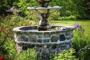 Inspect the fountain for water or moisture along its bottom or sides.