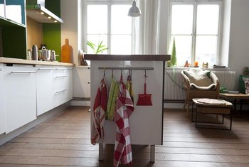 Turn an old dresser into a charming kitchen island for added workspace.