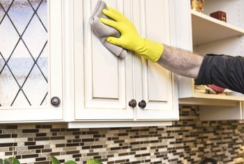 Clean the inside and outside of each cabinet to remove odors.