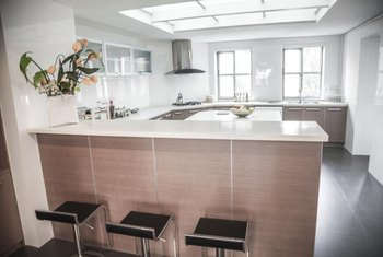 a fresh look is created with white silestone and white glass tile