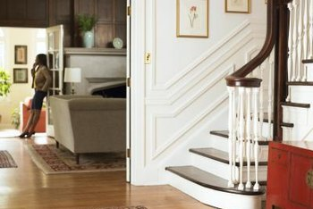 In feng shui, a front door with a staircase in front of it drains the chi from the home.