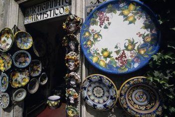 The souvenir decorative plates in the back of the cupboard will blossom anew as garden ornaments.