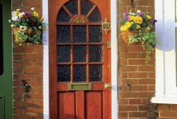 A red front door imparts a friendly welcome.