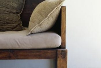 Fresh wood stain, assorted toss pillows and new seat cushions make ideal updates.