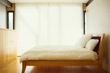 Using 1-inch lumber for the slats keeps a wooden bed frame light.