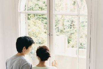 Arched windows are beautiful and a curtain adds functionality.