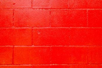 Gold glaze enhances features on a textured red wall.