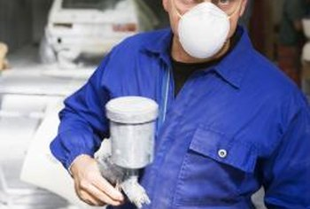 Wear protective gear when you spray epoxy paint.