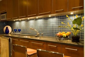 Attach decorative tile to plywood and the plywood to the wall for a removable backsplash.