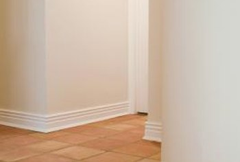 Removing the baseboards simplifies both tile removal and installation.
