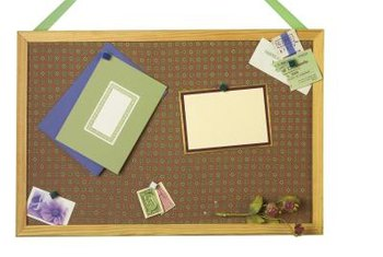 Update your plain bulletin board with fabric and ribbons.
