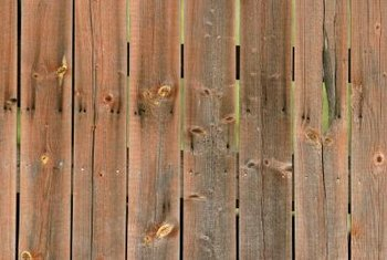 A wood fence provides privacy in an urban or suburban neighborhood.