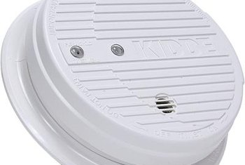 Reset a smoke detector to silence chirping after installing a new battery.