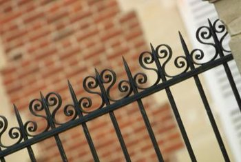 Prefabricated metal fence panels are easy to install.