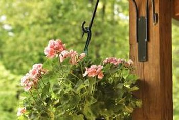 This outdoor planter features two curved arms with hooks and installs with only four screws through the mounting plate.