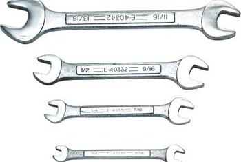 Select an open-end wrench that fits the locknuts on turnbuckles or spring hooks.